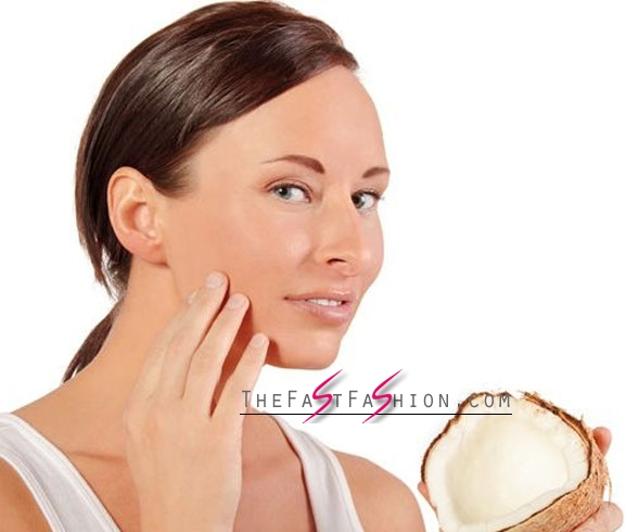 Massage The Face With Coconut Oil