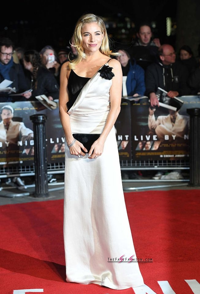 Sienna Miller in Lanvin Spring 2017 RTW Miller wore a black-and-white Lanvin evening dress with a slip silhouette to the European Premiere of her latest film, Live by Night, on Jan. 11 in London. (Photo: Getty Images)