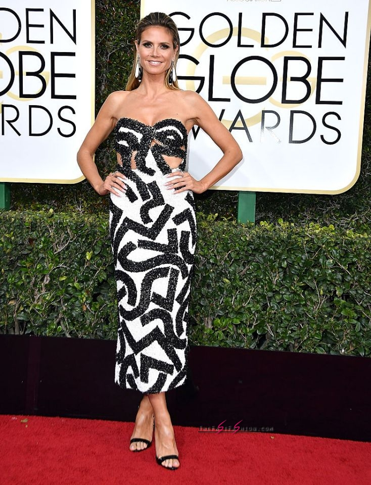 Heidi Klum in J. Mendel Fall 2016 Couture The supermodel arrived at the 74th Annual Golden Globe Awards in a black-and-white strapless midi dress. (Photo: Getty Images)