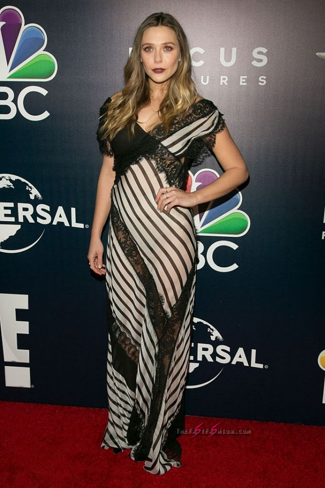 Elizabeth Olsen in Alberta Ferretti Resort 2017 The actress wore a striped Alberta Ferretti gown that featured lace detailing to NBCUniversal's 74th Annual Golden Globes After Party. She styled her hair in loose waves and wore a bold lip color. (Photo: Getty Images)
