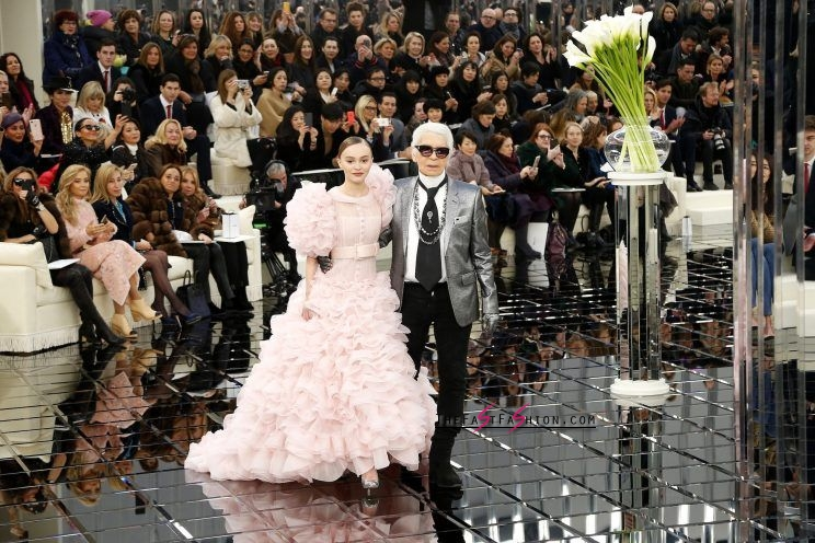 Designer Karl Lagerfeld walks the runway with Lily-Rose Depp. (Photo: Getty Images)