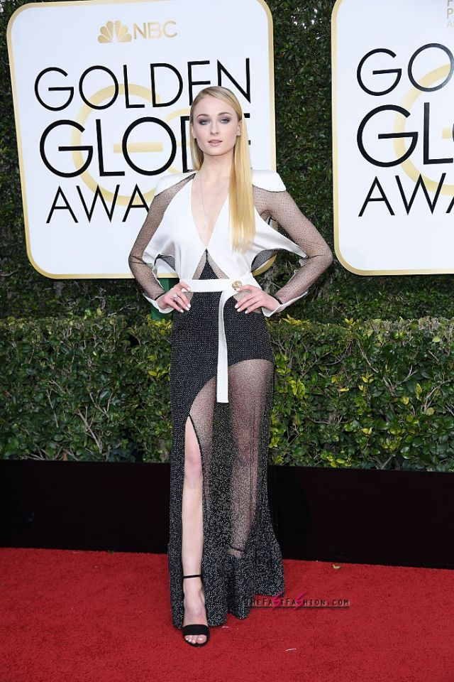 "Sophie Turner in Louis Vuitton Spring 2017 RTW The Game of Thrones actress wore a long-sleeved gown that featured a high slit and embellished panels to the 74th Annual Golden Globe Awards. On her look for the night, the star's stylist, Rebecca Corbin-Murray, told Teen Vogue, ""Sophie's dress was the closing look at the Louis Vuitton Spring 2017 show, and we both fell in love with it instantly."" (Photo: Getty Images)"