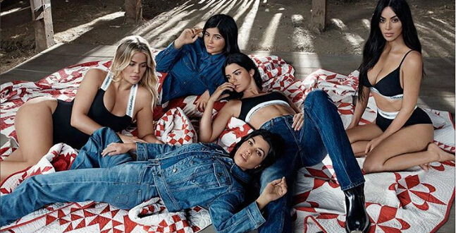 Pregnant Kylie Jenner covers stomach for flesh-baring shoot with sisters after FIVE MONTHS in hiding