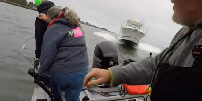 VIDEO Fishermen leap overboard before being hit by oncoming boat