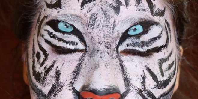 Paraplegic face painter doesn't allow her disability to stop her from creating works of art