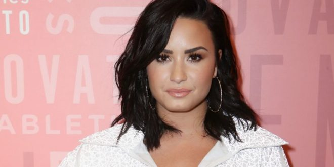 "Demi Lovato Claps Back at a Fan Who Called Her Team ""Rotten"""