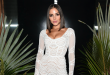 Olivia Culpo poses for Sports Ilustrated in long-sleeved thong swimsuit