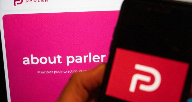 Parler's website is back online with message to 'lovers and haters'