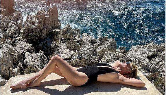 Sharon Stone rocks revealing black swimsuit in new sunbathing photos